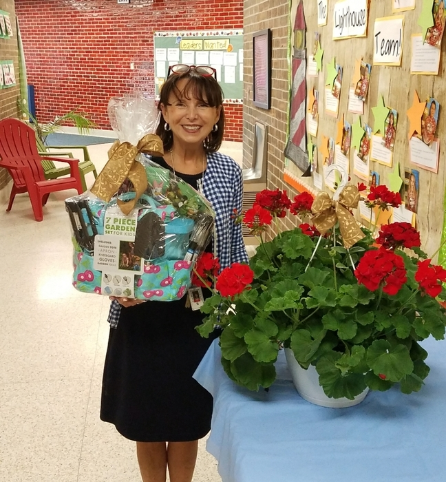 Mrs. Pitt won a gardening basket!