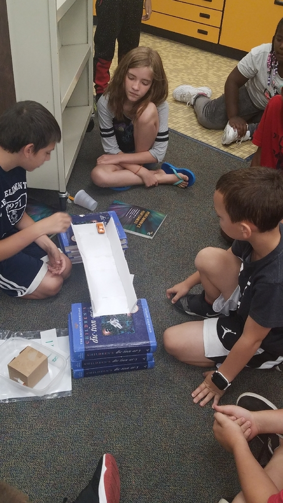 Students testing their bridges at Summer Reading Camp's STEAM day!